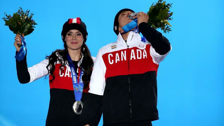 Canadians Tessa Virtue and Scott Moir wave to the crowd after receiving their silver medals in ice dance at the Sochi Olympics.