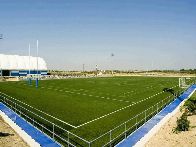 Realizacion de campos de futbol en cesped artficial con cinta de marcaje para futbol,balomano,canchas de baloncesto,etc...
