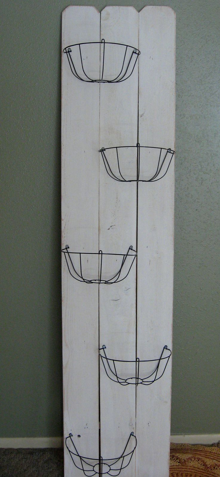 Easy peasy DIY wire basket storage or display... maybe add a name/saying above!