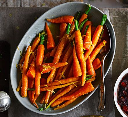 Pan-fry baby carrots with a zesty orange, ginger and honey sauce until golden and sticky for a festive and flavourful root vegetable side << leave the leaves on for an extra festive look