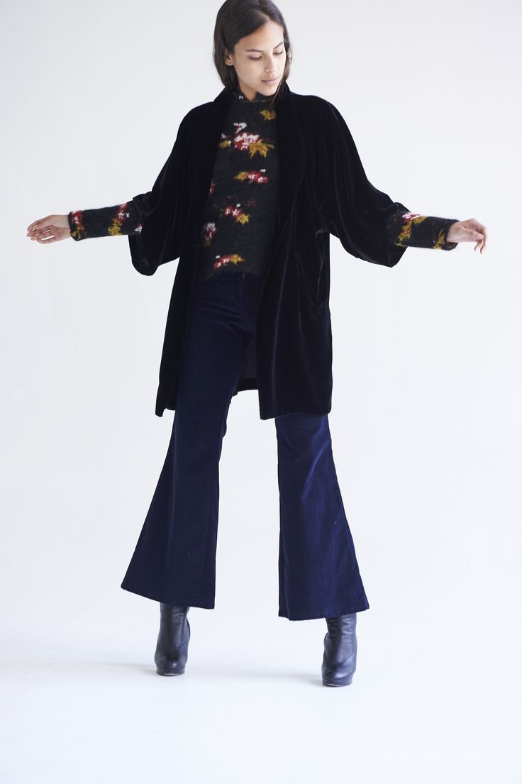 The Kimono Coat is made with the finest silk velvet. The pattern is long and oversize, a pocket on each side with a smoking collar. It fastens at the front with a hand cut glass button. One size only.  50% Silk 50% Viscose