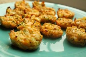 Zucchini Bites    1 Zucchini   1 cup cheddar   1 egg  1/4 onion   1c Bread Crumbs  mini Muffin Pan  Grate Zucchini   mix egg, bread crumbs, Zucchini, cheese, onion   Spoon into mini muffin pan  Bake at 400 for 15 minutes, or until cheese is melted and cup starts to form & brown & bubble.