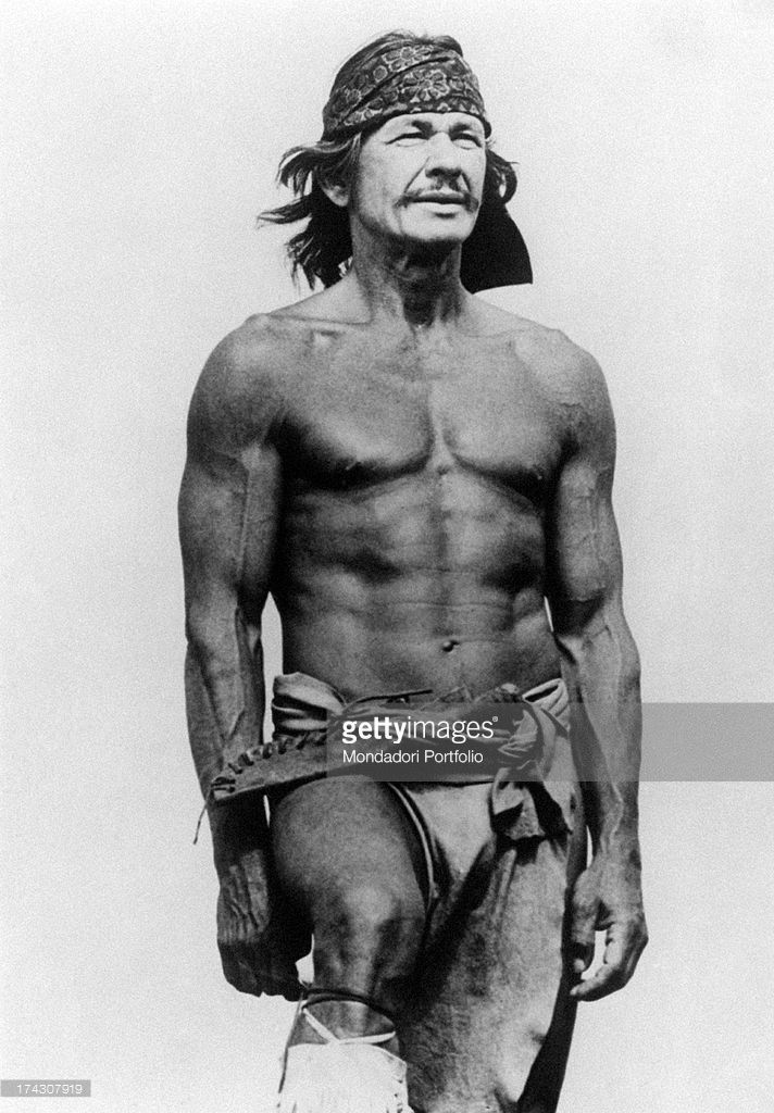 The US actor Charles Bronson (born Charles Dennis Buchinsky), bare-chested, in a scene of the film Chato's Land, directed by Michael Winner; Bronson plays the role of an Apachean Indian, Pardon Chato, who seeks revenge after his wife is murdered. USA, 1972..