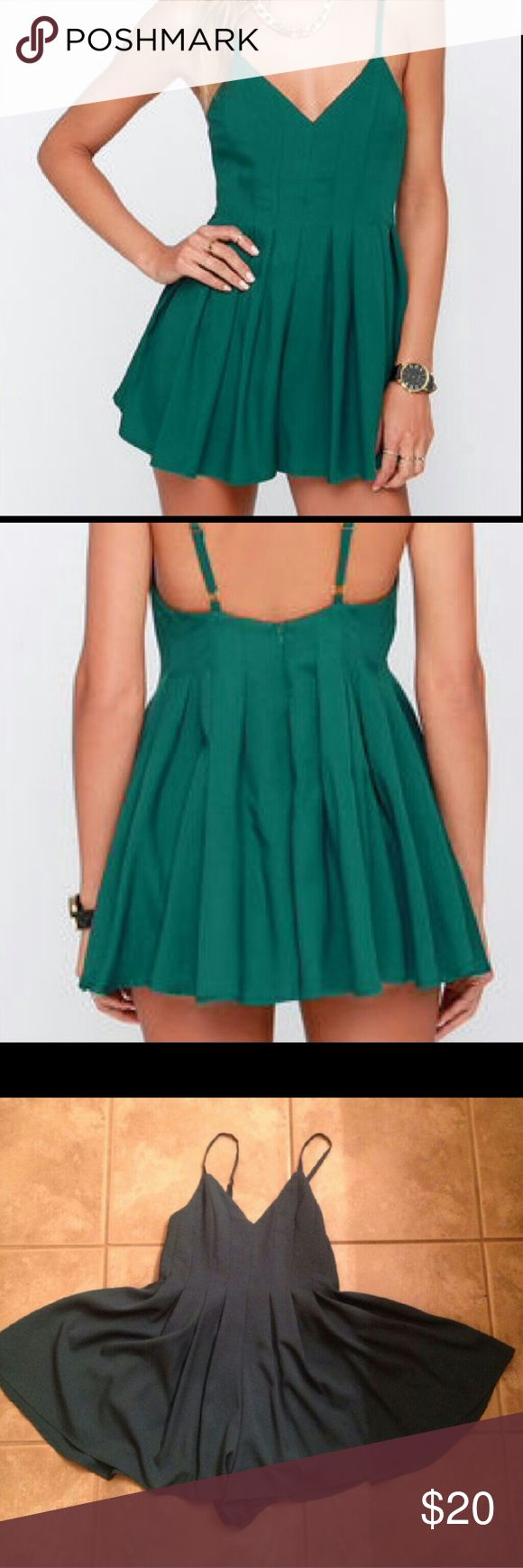 Lulus emerald green romper Worn three times. Great condition. Just don't wear it enough. Adjustable straps. Runs short, probably only suitable if you're 5' 1'' or under. Very cute on, perfect for festivals! Lulu's Pants Jumpsuits & Rompers