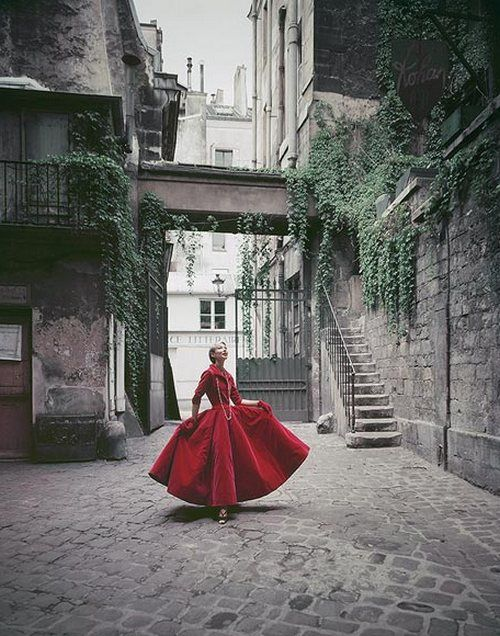 Dior gownin a Paris courtyard, 1955. Photo by Mark Shaw.