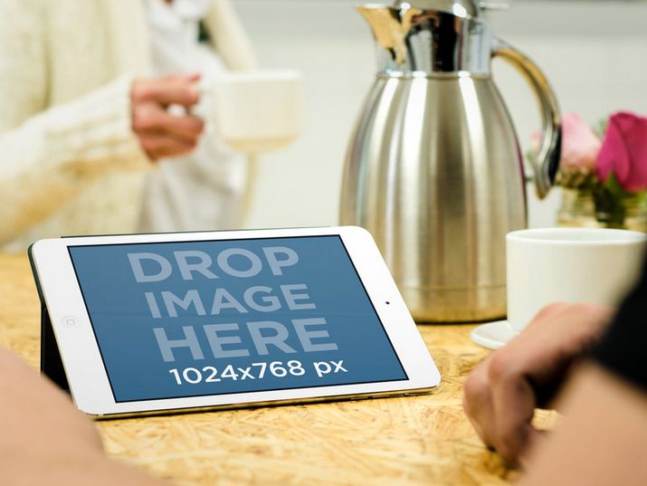 iPad Mini Mockup -Couple Having Coffee Try it here: https://placeit.net/#!/stages/couple-having-coffee-and-using-ipad/