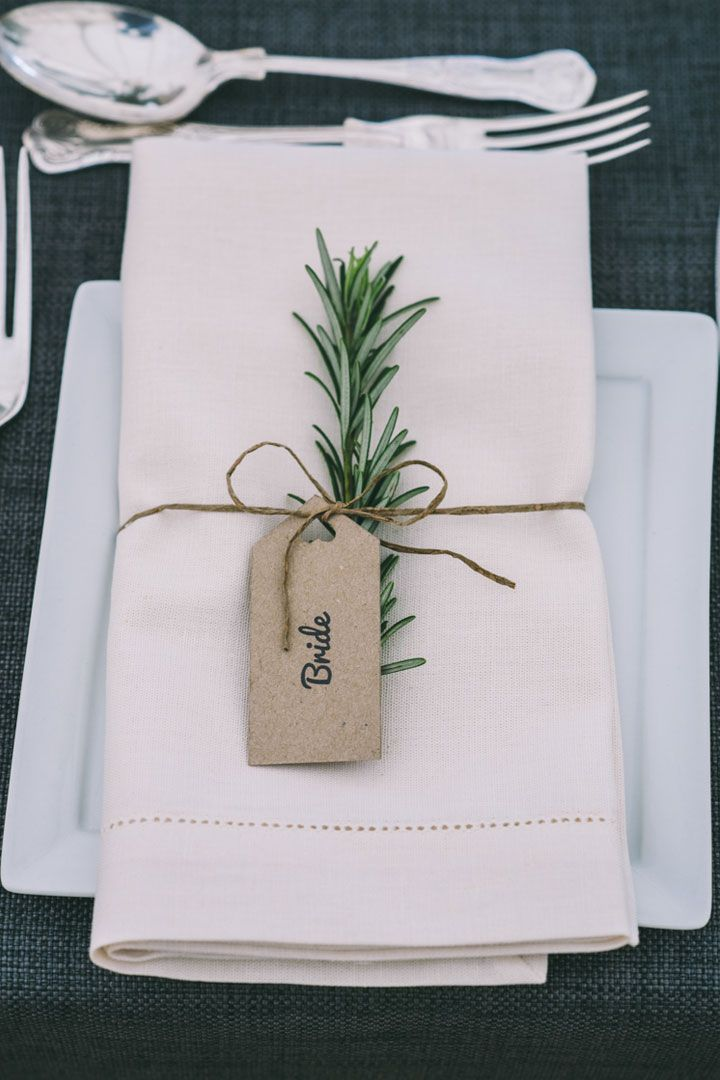 Rosemary accented wedding place name setting attached with DIY tag