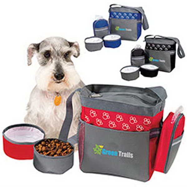 """Pet accessory bag. Includes two collapsible bowls for food and water, front pocket with hook and loop closure, side mesh pocket, and detachable zip case for storing treats or waste bags. Made of 600 denier polyester. Handle: 1 1/4"""" x 40 3/4"""". Perfect for walks in the backyard, park or beach! Multiple freight billing points."""