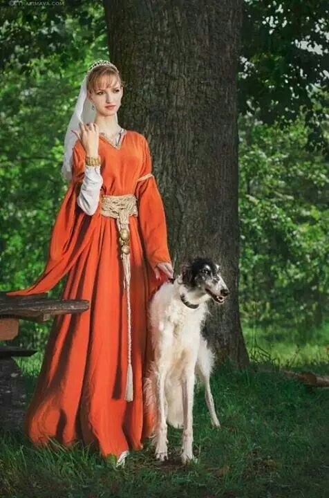 Lady in a medieval-style dress with borzoi. #animals #dogs #borzoi