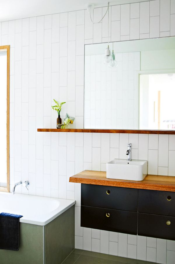 Nice wooden shelf to warm up the coolness of mirror n tiles; don't like the square basin, too small.