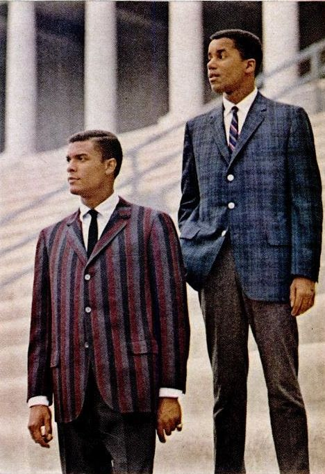 1960-1966. These gentlemen are wearing suits that are similar to those of the 50s, the only differences are that the ties, lapels, and pants get skinner. Also, the prints of the fabric get a little more wild and fun!(Maddi P.)