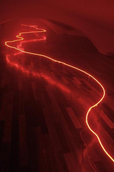 J'ai rêvé d'un autre monde (I dreamt about another world), 2008, by Claude Lévêque Site-specific work, Lambert Collection, le Grottone, Villa Medici, Roma Raised red neon, fog machine