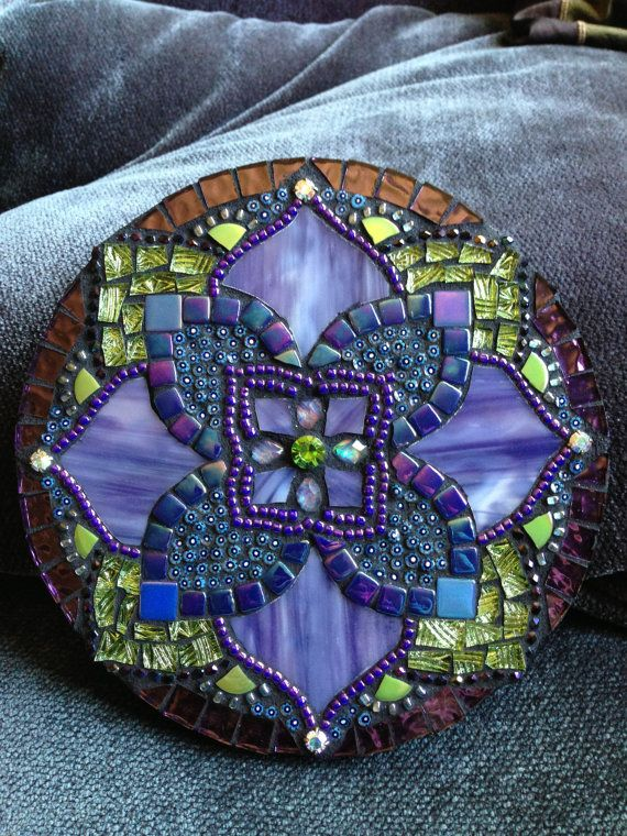 Beautiful mandala with purples, blues and greens, has a very soothing affect. I used a variegated stained glass and a very interesting green