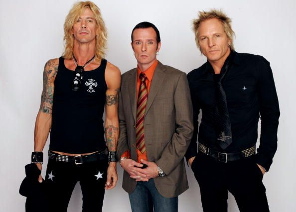Members of the rock band Velvet Revolver bassist Duff McKagan singer Scott Weiland and drummer Matt Sorum pose for a picture backstage during the...