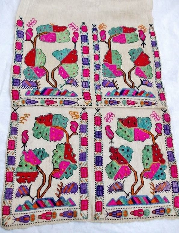 A women's 'uçkur' (sash / waist band), with embroidered ends.  From the Aegean region, late-Ottoman era, early 20th century.  With a stylized 'tree of life'-motif.  (Source: Antika Osmanlı Tekstil, Istanbul).