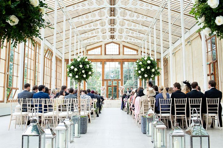 The fabulously decorated Nash Conservatory at Kew Gardens, just before the start of a wedding.