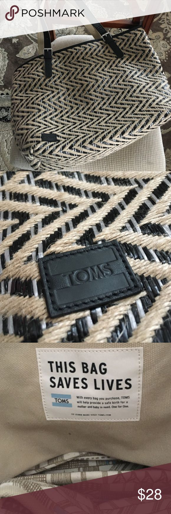 TOMS Bag, like new, never used Black and burlap TOMS bag, excellent condition.  Good size, can be used as a beach bag, diaper bag or for someone who likes to carry a bigger bag.  Black leather handles, lined with extra pockets on the inside. TOMS Bags Shoulder Bags