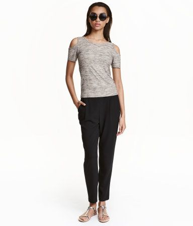 Jogger-style pants in woven fabric. High waist with elastication at back, side pockets, and wide, tapered legs.