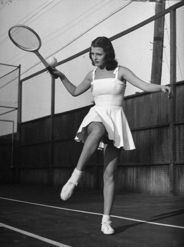 Rita Hayworth models tennis fashions in 1940 http://www.vintag.es/2013/06/pictures-of-tennis-players-in-past.html#more