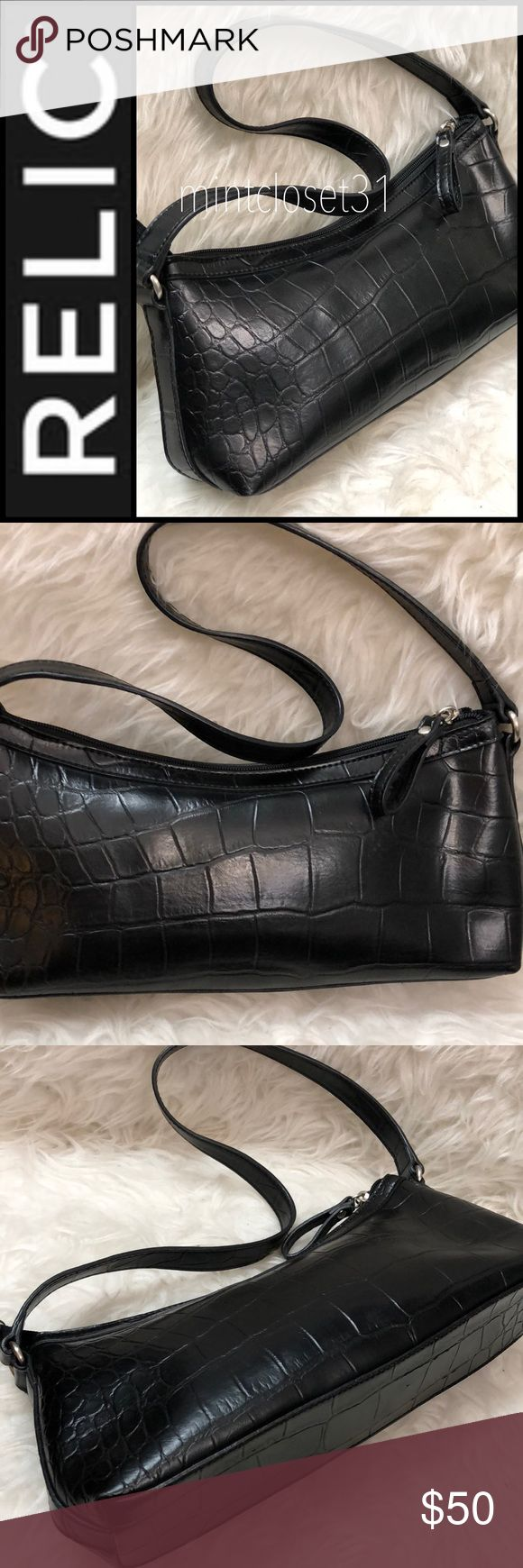 Relic Shoulder Bag Relic Signature Bag in Beautiful Croc Style Pattern! Handcrafted Made with Finest Material with Shoulder Strap That Dropd about 10 Inches! Silver Tone Hardware!  Top Zipper Opens To Fully Lined Interior with Zip and Slip Pockets! Timeless Design and Excellent Quality! Medium Sized Bag in used Good Condition! Relic Bags Shoulder Bags