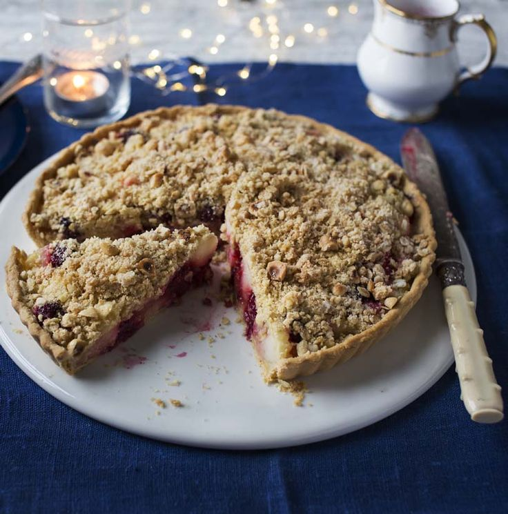 The delicious dessert is filled to the brim with juicy apples and blackberries.
