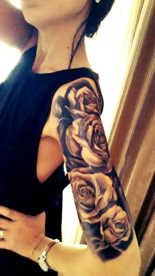 Half sleeve black roses tattoo