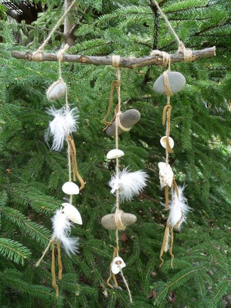 rustic wind chimes with stones and feathers