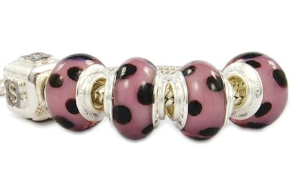 dalmatian glass beads with lilac motif.