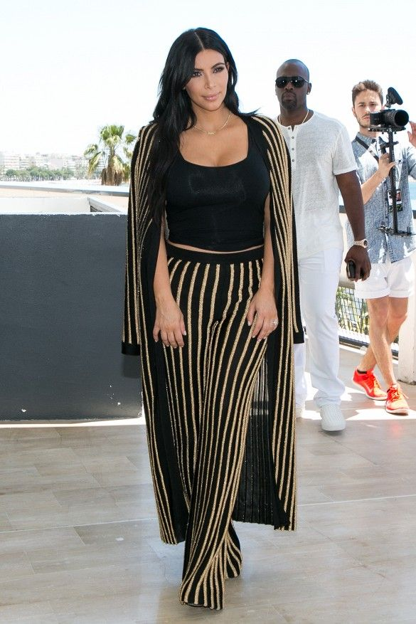 Kim Kardashian wears a striped Balmain look