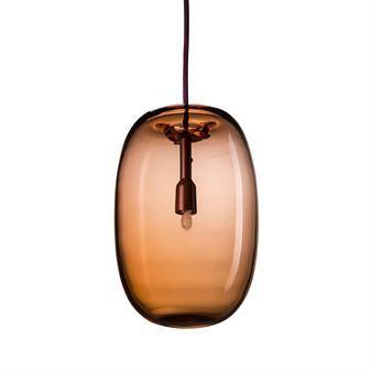 Pebble är en ståtlig taklampa i trycksvarvad metall eller handblåst glas som är designad av Joel Karlsson för svenska Örsjö Belysning. Inspirationen till Pebble kom från idén att skapa en lampa som både kapslade in ljuset samtidigt som det gav ett vackert sken. Tack vare detta finns lampan tillgänglig i olika varianter där metallvarianten ger ett starkt riktat ljus nedåt medan glasvarianten skapar ett mer behagligt och stämningsfullt sken.