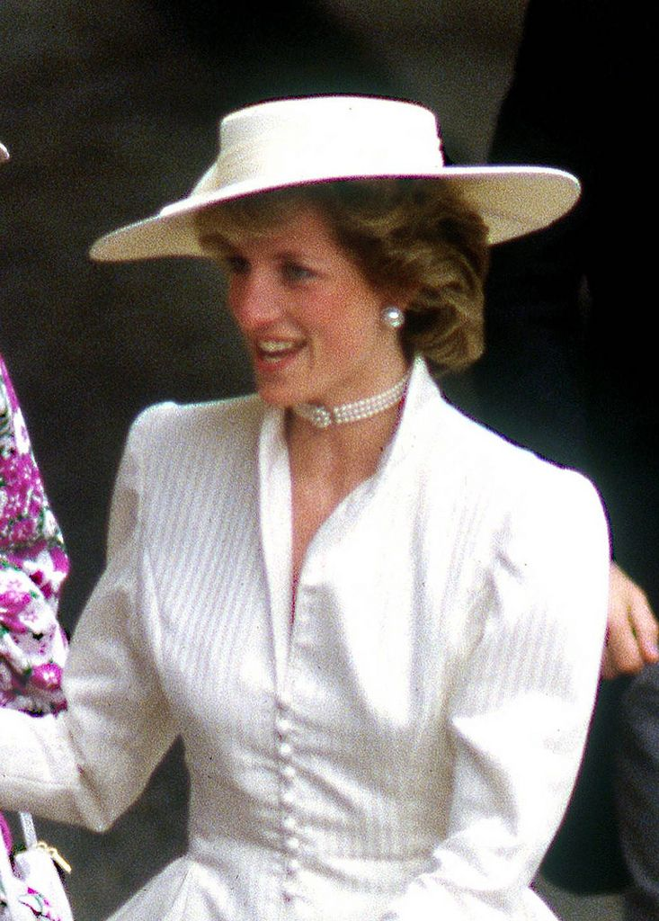 Princess Diana wearing a cream peplum jacket and Philip Somerville hat to Royal Ascot June 1986.