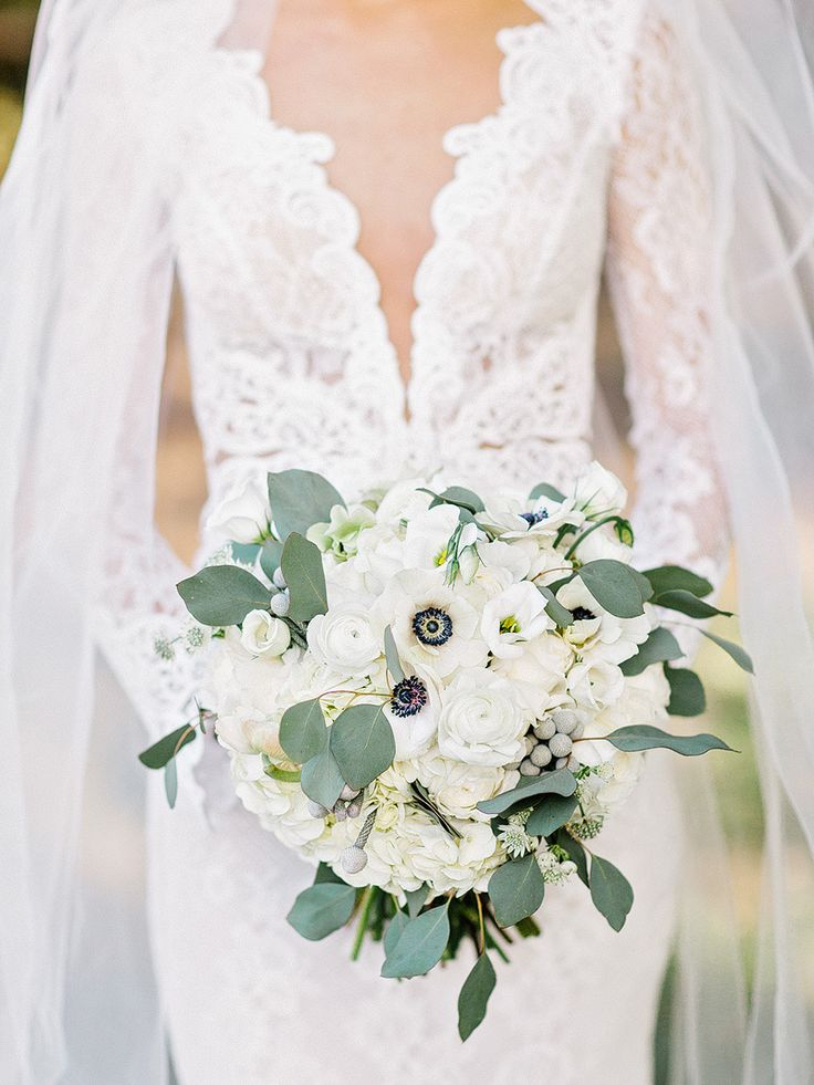 Anemone, hydrangea, ranunculus, and eucalyptus wedding bouquet: Photography: Amy Arrington Photography - www.amyarrington.com   Read More on SMP: http://www.stylemepretty.com/2016/11/15//