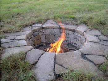 Sunken Firepit lined with Stone. <3