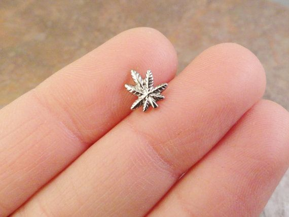 316L surgical steel marajuana leaf cartliage ear piercing cuff. Post is 18 gauge and 5/16 long. Pot leaf charm measures a tiny 8mm. Can also be used in a tragus piercing. This earring has a screw on ball backing.  For more body piercing jewelry: http://www.etsy.com/shop/MidnightsMojo?section_id=11272553  To see dream catcher necklaces and bracelets click here: http://www.etsy.com/shop/MidnightsMojo?section_id=10745497