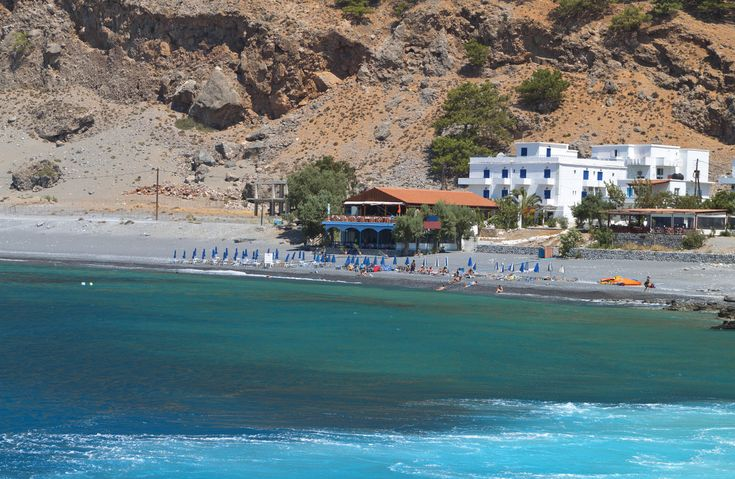 Agia Roumeli beach - located at the exit of Samaria gorge,with very small black pebbles and the blue waters of the Libyan sea.  #Greece #Crete #Chania #Terrabook #GreekIslands #Travel #GreeceTravel #GreecePhotografy #GreekPhotos #Traveling #Travelling #Holiday #Summer