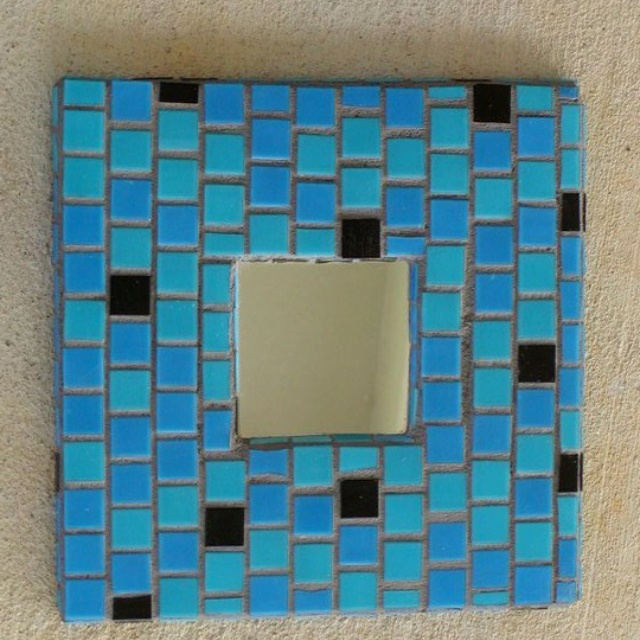 Ikea Malma mirror that I mosaic tiled