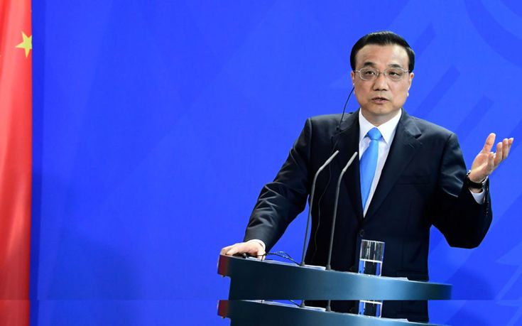 China vows to adhere to Paris climate deal   By AFP            Chinese Prime Minister Li Keqiang gives a joint press conference with the G...