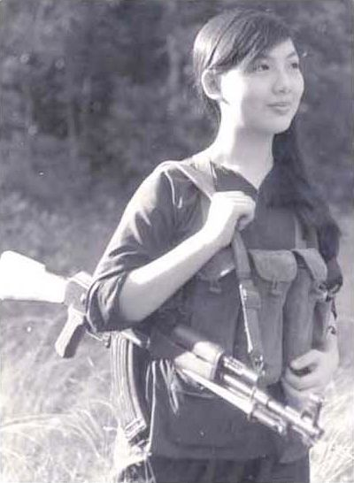 Beautiful young Viet Cong girl fighter