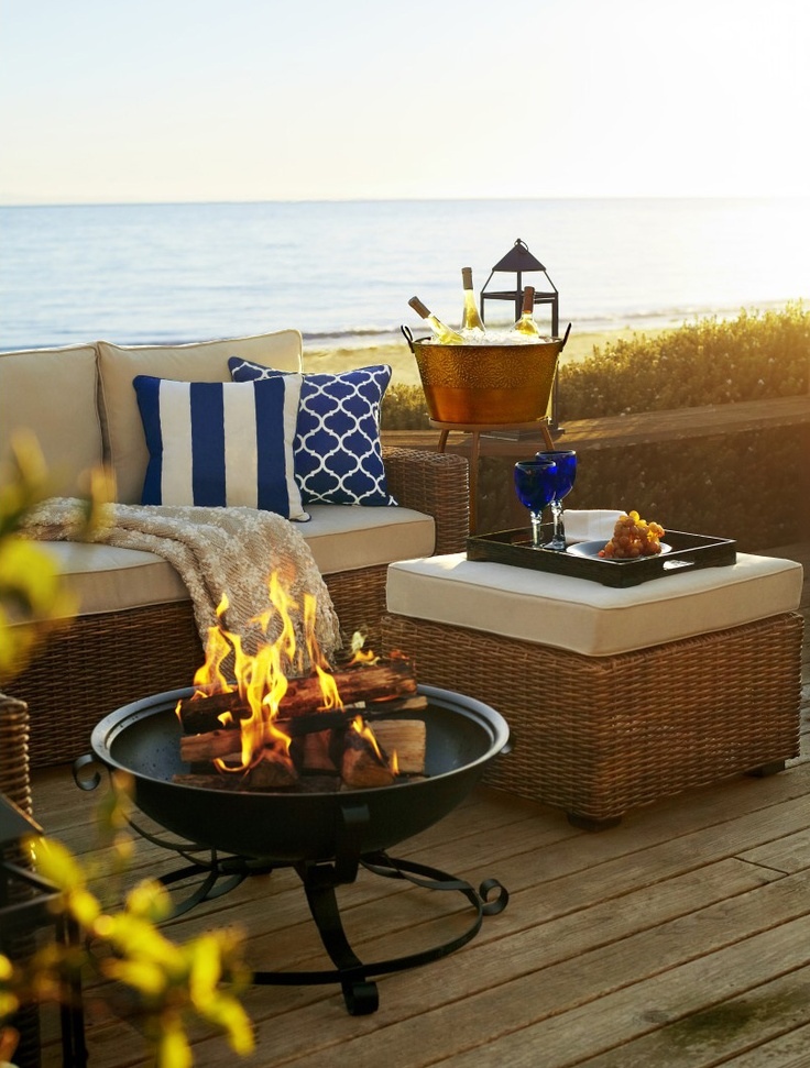 Gather around our dramatic Zira Fire Pit Table on cool summer nights