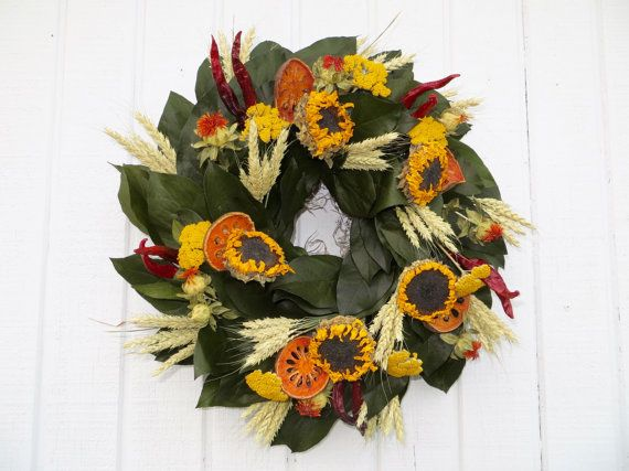 This wreath is 18 inches in diameter. It is a nice cheery wreath. The base is made with basil salal and decorated with sunflowers, wheat, red peppers, saffllowers, yellow yarrow and dried quince.  This wreath should be placed out of the direct sunlight and needs protection from moisture.  Since my wreath are perishable they are not returnable.  Thank you for visiting my shop.