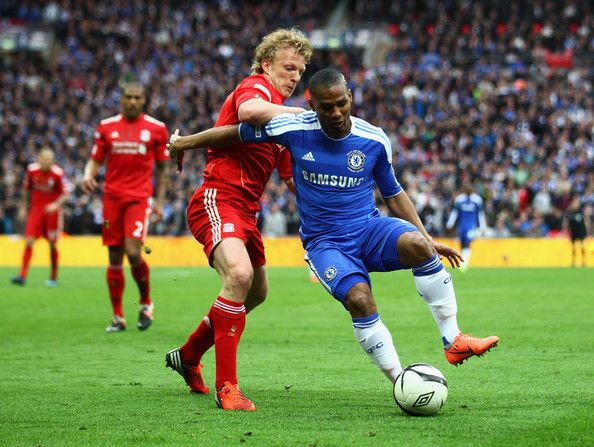 Dirk Kuyt of Liverpool clashes with Florent Malouda of Chelsea  during the FA Cup with Budweiser Final match between Liverpool and Chelsea at Wembley Stadium on May 5, 2012 in London, England.
