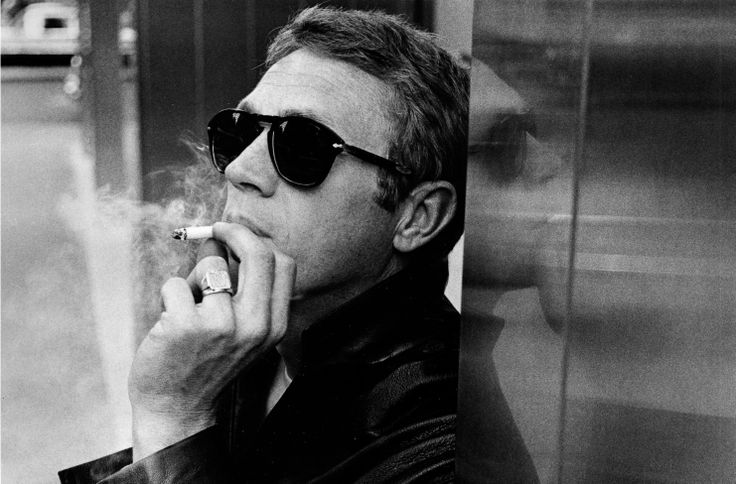 Steve McQueen wearing Persol 714.