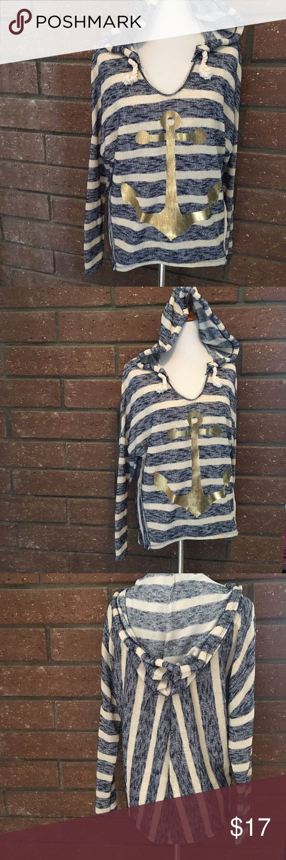"""Blushed Nautical Anchor Hoodie This striped nautical hoodie is great for summer nights or as a bathing suit cover! It can also be layered in cooler months. Adorable rope drawstrings and gold anchor. 48% polyester, 43% rayon, 4% spandex. Great preloved condition. Measurements flat are 23.5"""" pit to pit & slight high low is 23"""" front to 26"""" back long. Blushed Tops Sweatshirts & Hoodies"""