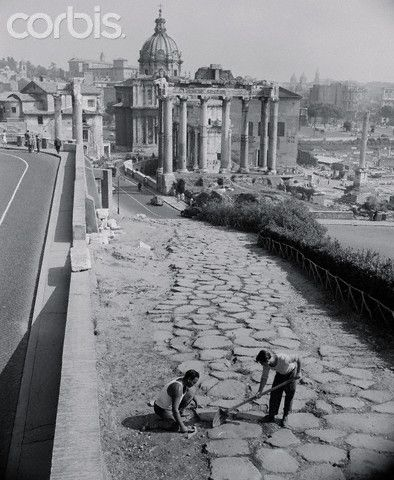 Repairing the 2,000 Year Old Road - 1955 Roma Path of the Glory That Was Rome. Rome: Repairs are made to a 2,000-year-old Roman road which is part of the ruins of the ancient Forum in the Eternal City. A 100-yard section remains of the pathway, which may have borne the footsteps of Roman Emperors.    #TuscanyAgriturismoGiratola