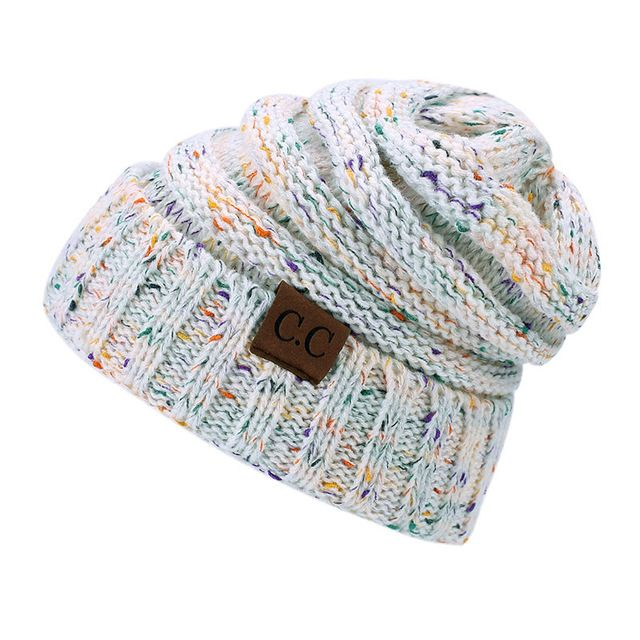 3999758499c LONSUNNOR 2017 New Trendy CC Warm Winter Hat For Women Ponytail Beanie  Stretch Cable Knit Messy Bun Hats Soft Ski Cap Wholesale-in Skullies    Beanies from ...