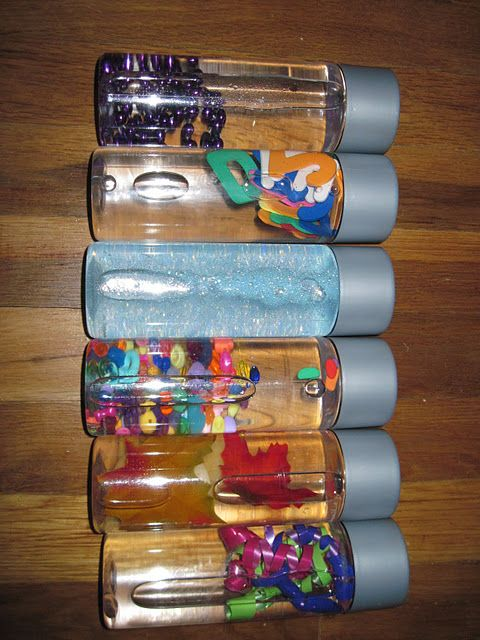 Sensory bottles!  They used Voss water bottles. Not sure where to find them but any water bottle will work. use mineral oil for a way to slow down the materials in the bottle. I usually do 2/3 water to 1/3 oil.  Can also do just rice and small objects for I-Spy bottles.
