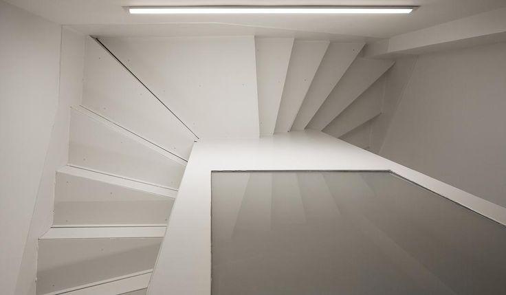 Escalera de caracol encerrada en una caja. Foto de @roi_alonso de la reforma de portal y escalera http://somaa.es/proyecto/la-ascension/ #arquitectura #arquitecturainterior #galicia #coruña