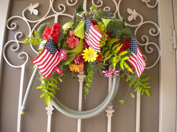 Repurpose an old garden hose into a front door wreath. So very easy. Flowers can be changed out as the season progresses.