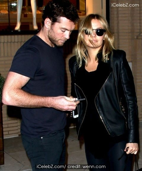 Sam Worthington and Lara Bingle leave Barney's New York in Beverly Hills http://www.icelebz.com/events/sam_worthington_and_lara_bingle_leave_barney_s_new_york_in_beverly_hills/