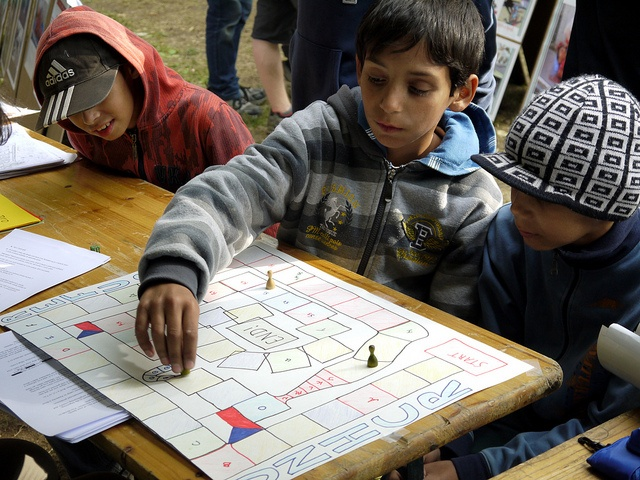 Children visiting RefuFest, a festival offering its visitors a cross-cultural experience with programming that reflects the diverse make up of people living in the Czech Republic, play board games. © UNHCR/K. Machova